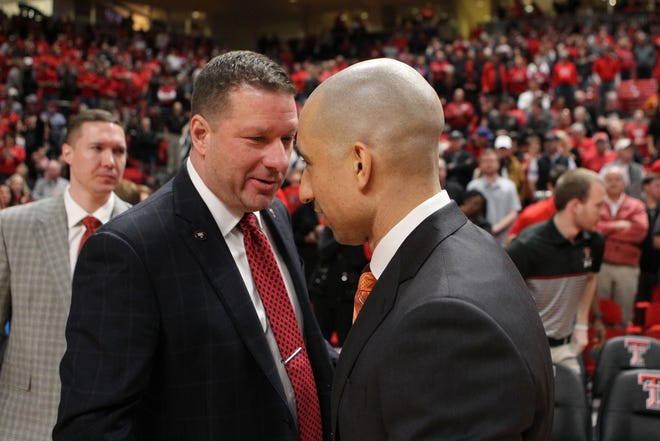 Then-Texas Tech coach Chris Beard, left, greets then-Texas coach Shaka Smart before a past game in Lubbock. Smart left UT after this past season and is now the head coach at Marquette and Beard, after a successful five seasons with the Red Raiders, is coaching the Longhorns.