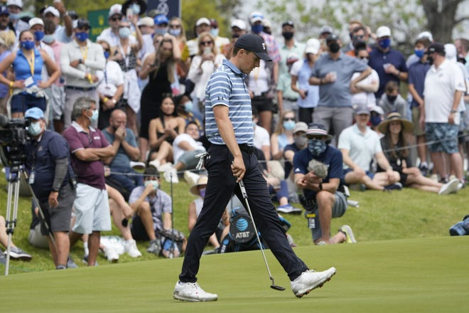 Texas ex Jordan Spieth walks across the 18th green after missing a birdie putt during a round of 16 match against Matt Kuchar in the Dell Match Play tournament Saturday. Kuchar won the hole and the match.