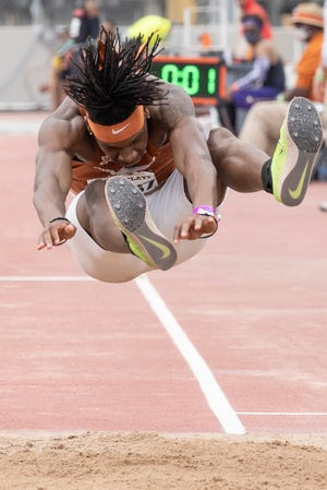 Texas' Stacy Brown Jr. competes in the men's triple jump Saturday at the Texas Relays. He won the event with a mark of 51 feet, 2¾ inches.