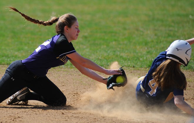 Sebring McKinley's Kalyla Caliguire dives to make a tag at second base in a game against United at Akenhead Field Saturday, March 27, 2021.
