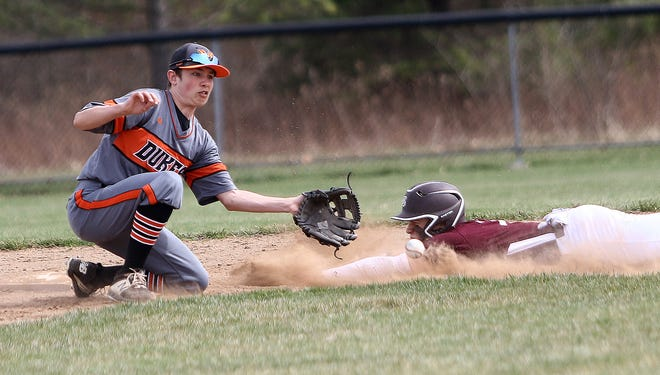 Marlington fielder Nate Johnson, left, watches the ball as Boardman's Ty Ventresco, right, slides into second base during their game at Marlington High School Saturday, March 27, 2021.