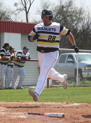Madill's Griffon Williams scores a run Saturday during a 12-2 win over Davis at the Murray County Shootout.