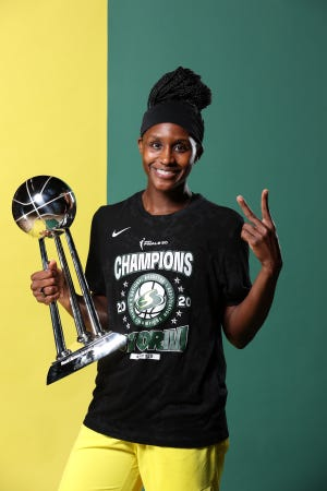 Crystal Langhorne of the Seattle Storm poses for a portrait with the WNBA Championship Trophy