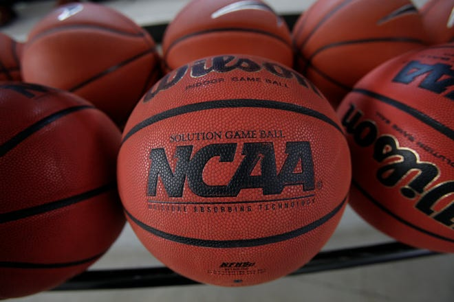 FILE - In this March 22, 2010, file photo, basketballs are seen before Northern Iowa's NCAA college basketball practice in Cedar Falls, Iowa. NCAA rules essentially set up college sports to be a de facto farm system for professional teams and the people who defend college sports want no part of that. logo (AP Photo/Charlie Neibergall, File)