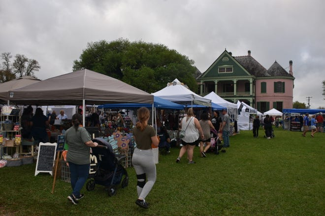 Visitors browse crafts booths at Southdown's Spring Marketplace on March 27, 2021, in Houma. The festival, held in the spring and fall, benefits Southdown Plantation and the Terrebonne Museum.