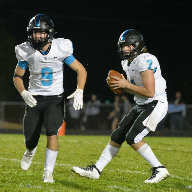 Oak Grove quarterback Dylan Barker looks for a receiver after faking a handoff to Aiden Shewcow in the Grizzlies' 28-26 win over Ledford. [Mike Duprez/The Dispatch]