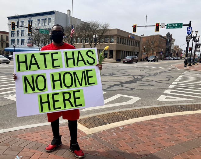 Tyrone Harwell stands on the square in downtown Wooster during the 300th consecutive day of daily anti-racism rallies. Harwell encouraged other community members and residents to join.