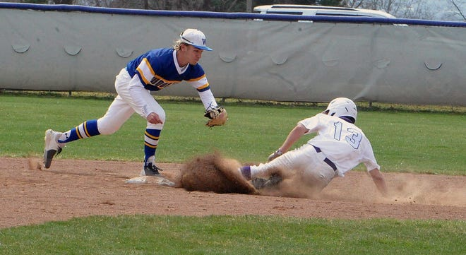 Wooster's Tyler Pettorini tries to get the tag on Triway's Colton Snyder.
