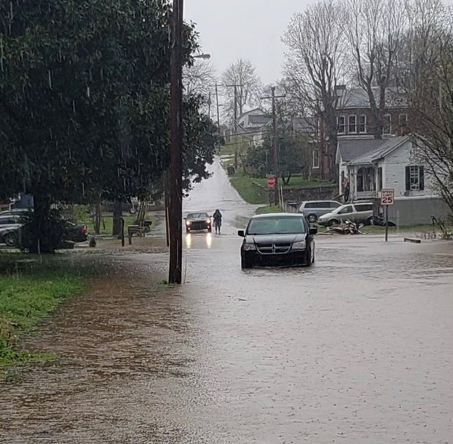 Columbia Fire & Rescue responded to a family stranded in a van caught in high waters at 11th and School streets in Columbia during a Flash Flood Watch on March 27, 2021.