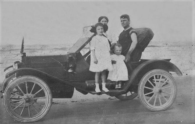 This family shows that driving on the beach was popular around 1910 in Flagler Beach.