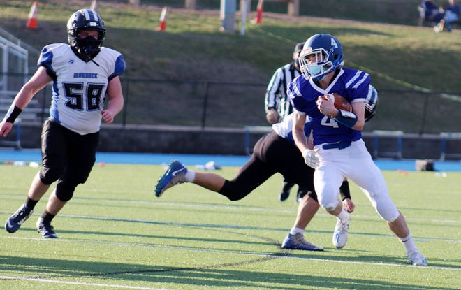 Lunenburg wide receiver William Peplowski avoids a tackle during Friday's game against visiting Murdock.