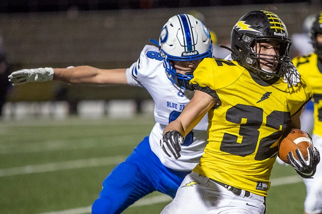 Galesburg High School junior running back Alex Egipciaco eyes the corner of the endzone as he eludes Quincy's Clay Hansen during the Silver Streaks' 46-17 WB6 Conference win over the Blue Devils on Friday, March 24, 2021 at Van Dyke Field.