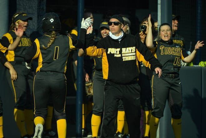 Fort Hays State coach Adrian Pilkington high-fives Grace Philop during a game at Washburn earlier this season.