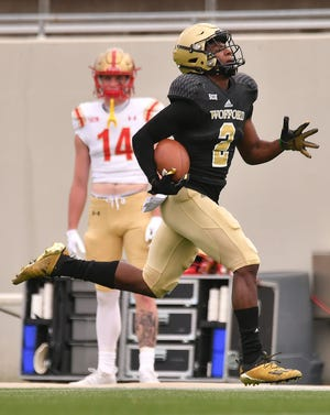 The Wofford Terriers take on VMI during football action at Gibbs Stadium in Spartanburg Saturday afternoon, March 27, 2021. Wofford wide receiver T.J. Luther (2) runs the ball across the field for a touchdown in the first minute of the game.