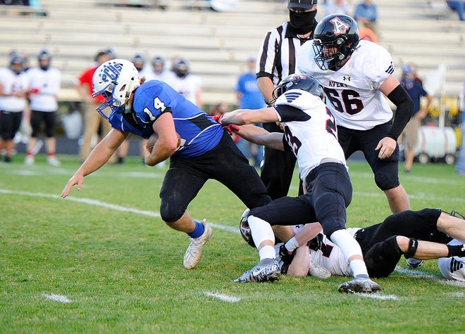 Polk County sophomore fullback Angus Weaver breaks through the Avery County defense for a big gain on Friday night at Polk.