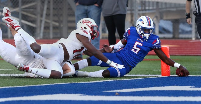 Hutchinson Community College's quarterback CJ Ogbonna (5) scores a touchdown past Coffeyville's Jared Miles (11) during their game Friday night at Gowans Stadium. Hutchinson defeated Coffeyville 33-10.