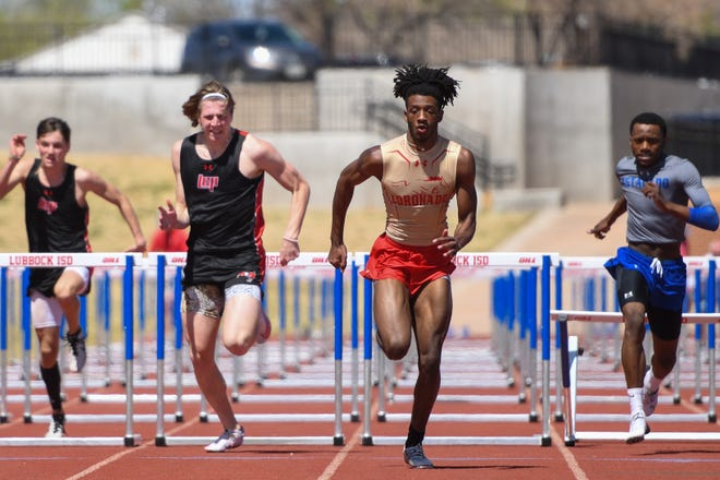 Lubbock-Cooper's Brady Barnett and Coronado's Imari Jones race against one another in the 110-meter hurdles during the Lubbock ISD Invitational on March 27 at PlainsCapital Park at Lowrey Field.