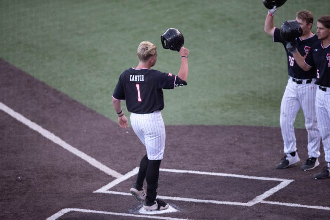 Texas Tech's Dillon Carter tips his helmet to teammates Braxton Fulford (26) and Drew Woodcox (5) after hitting a two-run home run during a nonconference game Friday at Dan Law Field at Rip Griffin Park.