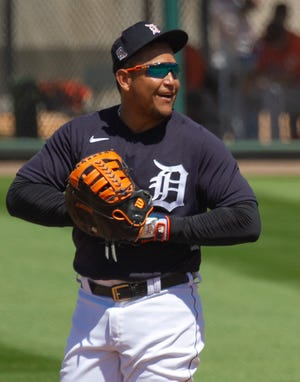 Detroit Tigers first baseman Miguel Cabrera smiles in between batters against the Baltimore Orioles at Publix Field at Joker Marchant Stadium on March 14.