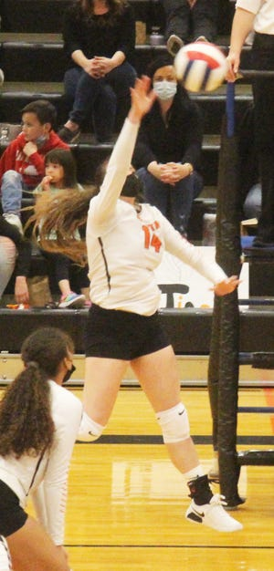La Junta High School's Raini Tafoya hits the ball over the net in Friday's match against Pueblo Centennial. Tafoya had 11 kills as the Tigers defeated the Bulldogs in five sets.