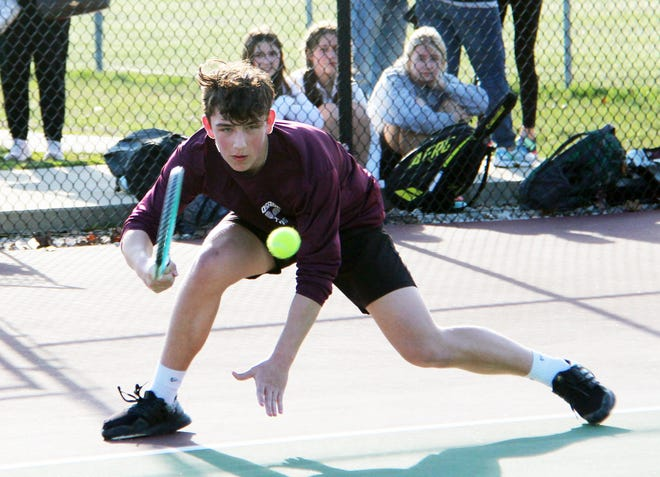 Osage's Vladimir Nahapeteyan looks to return a ball in a singles match against Helias Catholic on March 26 in Osage Beach.