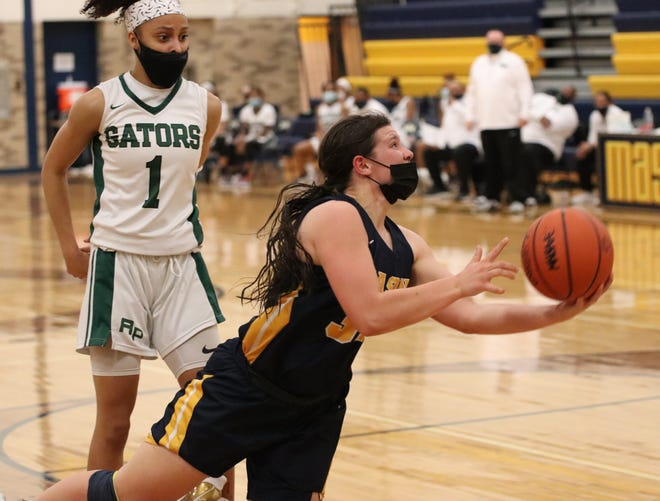 Erie Mason's Lizzie Liedel goes to the basket against Ypsilanti Arbor Prep's Mya Petticord in the finals of the Division 3 District at Erie Mason Friday night.
