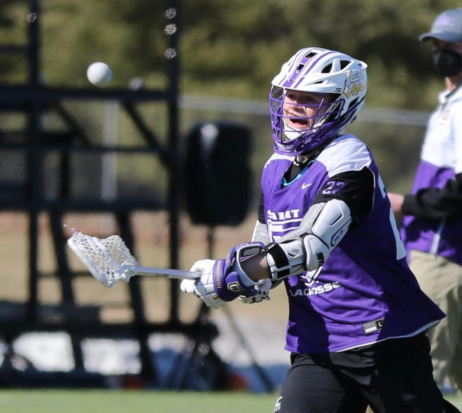 Ashland alum and St. Michael's College freshman Dylan Morgan fires a shot in a game against American International College on March 20, 2021. Morgan scored five goals and added two assists in the Purple Knights' 14-3 win over the Yellow Jackets.