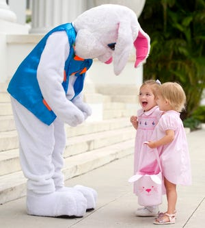 Children interact with the Easter Bunny during the 2018 Easter egg hunt at the Flagler Museum. Although the museum is not hosting a hunt this year, other venues are offering their own COVID-safe versions of the traditional spring event.