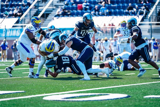 URI defenders converge on Delaware's Anthony Paoletti during Saturday's game at Meade Stadium in South Kingstown.