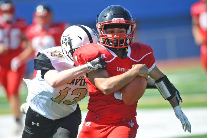 While the ball looks like it's about to slip the grasp of Juanita Sanchez/Providence Country Day quarterback Noel Torres, he managed to hold on to avoid a fumble. Torres was huge Saturday, running for 127 yards and the lone score of the game in the Cavaliers' win over Davies.