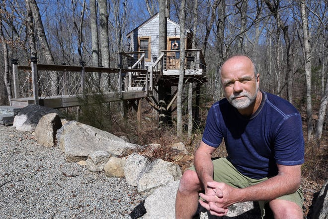 Jeffrey Morse of Richmond with the treehouse that he built at the edge of his property and was renting on the short-term market.