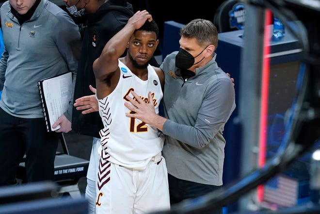 Loyola Chicago head coach Porter Moser, right, consoles guard Marquise Kennedy after a Sweet 16 loss against Oregon State in the NCAA men's college basketball tournament at Bankers Life Fieldhouse, Saturday, March 27, 2021, in Indianapolis. Oregon State won 65-58.