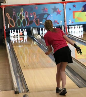 Paige Carpenter, a junior at Harlem, roots for a strike in the final game of the NIBPA Top 16 Tournament on Friday at the Cherry Bowl in Cherry Valley.