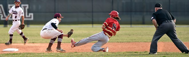 Braden River Pirates' Ryan Waldschmidt (21) tags out Cardinal Mooney Cougars' Aidan Troy (14) the first inning at second base. The Pirates won at home, 7-4 over the Cougars in a non-conference game on Friday night, March 26, 2021, in Bradenton.