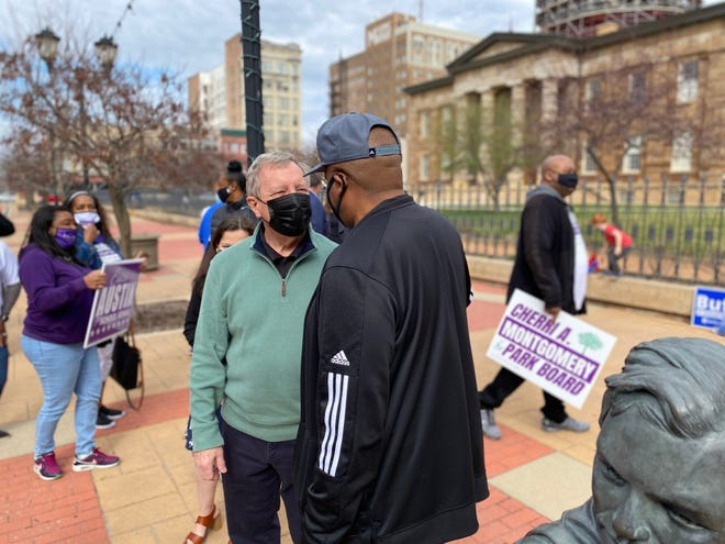 U.S Sen. Dick Durbin talks with local Democrats in front of the Old State Capitol in Springfield on Saturday, ahead of the consolidated general election on April 6.