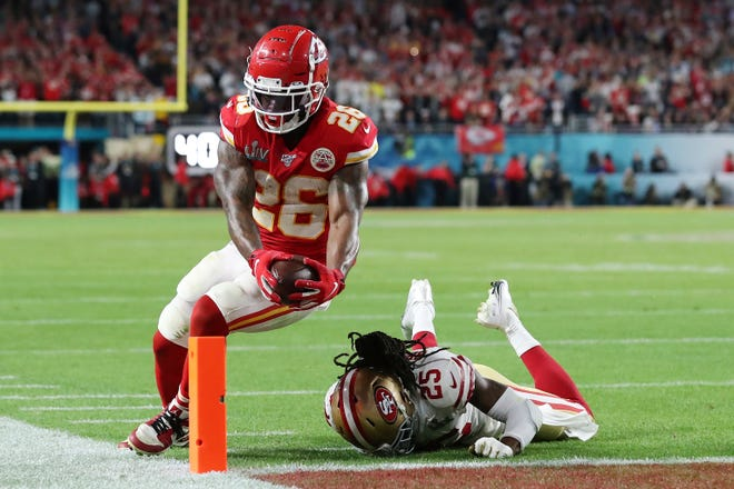 Kansas City running back Damien Williams (26) runs the ball in for a touchdown while San Francisco 49ers cornerback Richard Sherman (25) attempts to tackle in Super Bowl 54 on Sunday, Feb. 2, 2020.