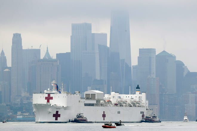 The Navy hospital ship USNS Comfort passes lower Manhattan on its way to docking in New York on March 30, 2020, to help relieve the coronavirus crisis gripping the city's hospitals.