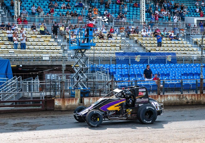 Chris Windom takes the checkered flag to win the 2018 USAC Silver Crown Tony Bettenhausen 100 on the Springfield Mile.