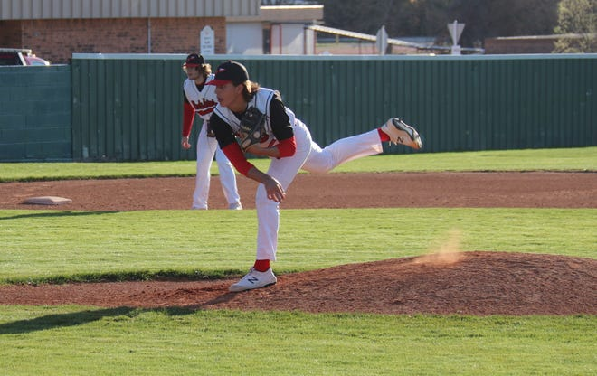 McLoud pitcher Collin Gibson fires a pitch Friday night against the Latta Panthers.