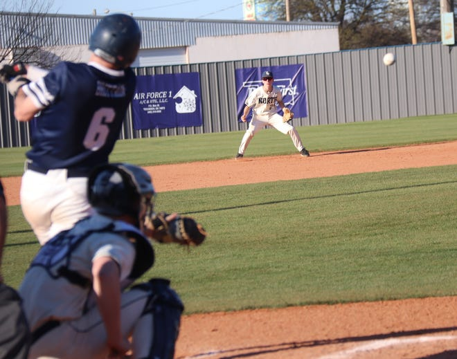 Shawnee's Bauer Brittain lines a single up the middle for one of the Wolves' only two hits against Edmond North Friday.