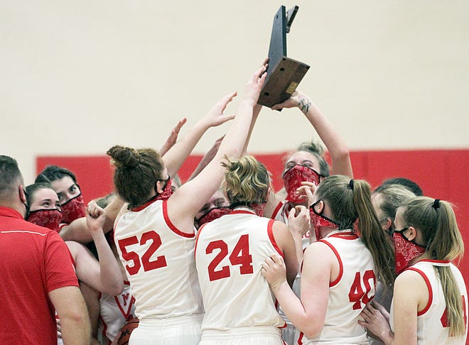 The Colon Magi celebrate winning a district championship on Friday night.