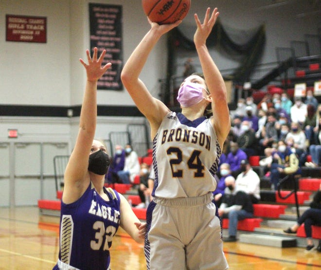 Jenna Salek rises up to score two points for Bronson in the district finals against Schoolcraft on Friday night.