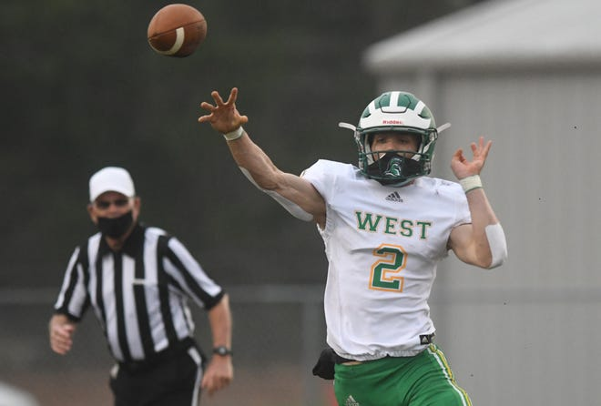 West Brunswick quarterback Monzelle Campbell throws at Topsail in Hampstead, N.C., Friday, March 26, 2021.     [MATT BORN/STARNEWS]