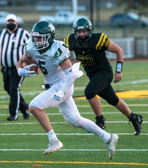 Oakmont's Ryan McKenna runs for a first down during the third quarter last Friday at Tantasqua.