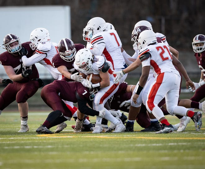 South High's Angelo LaRose finds a way to run for his yardage.