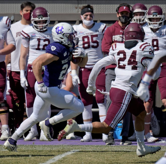 It's off to the races, as Holy Cross running back Peter Oliver streaks down the sideline, chased by Fordham's Stephen Williams II in a game earlier this season.