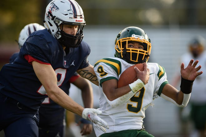 In the final two games of the regular seasons, Pine Forest running back Xavier Bynes (9) scored five touchdowns and averaged 116 rushing yards to help the Trojans earn a playoff bid.