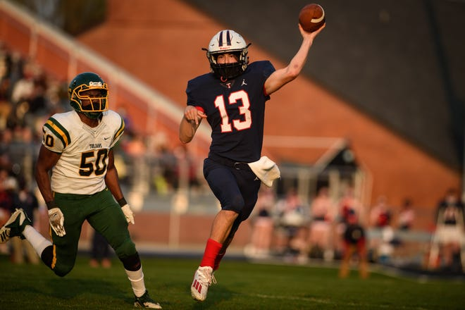 Dante Garcia passes during the Pine Forest at Terry Sanford football game on Friday, March 26, 2021.