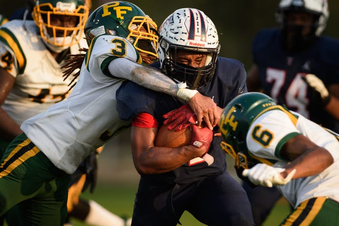Terry Sanford running back Jre Jones had 140 yards and a touchdown on 27 carries for the Bulldogs, but Pine Forest's D'lano Blevins (3) and Blake Paul (6) made plays throughout the night for a tough Trojan defense.