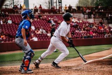 Wes Clarke hits a three-run home run Saturday against Florida.